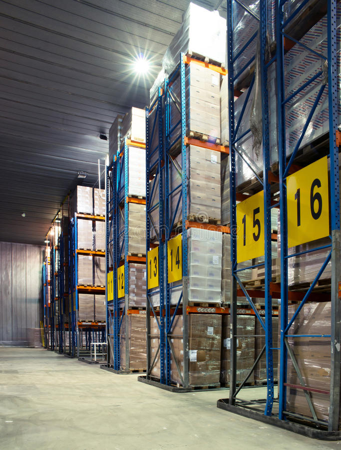 Large cold warehouse. Frozen food at shelves in cold warehouse stock image