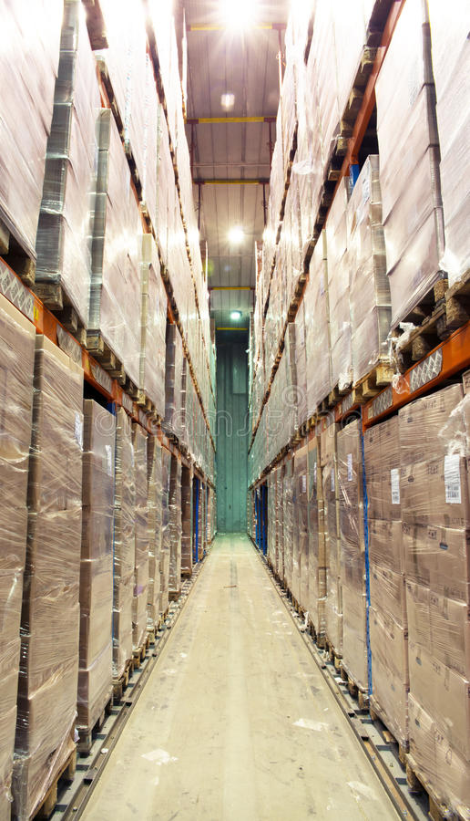 Large cold warehouse. Frozen food at shelves in cold warehouse stock photography