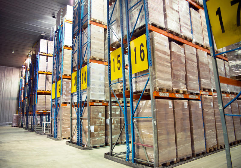 Large cold warehouse. Frozen food at shelves in cold warehouse stock photos
