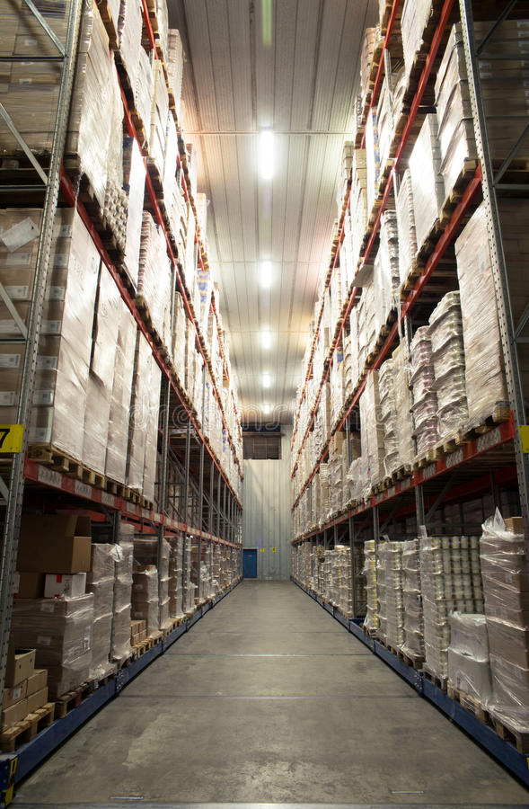 Large cold warehouse. Frozen food at shelves in cold warehouse royalty free stock image