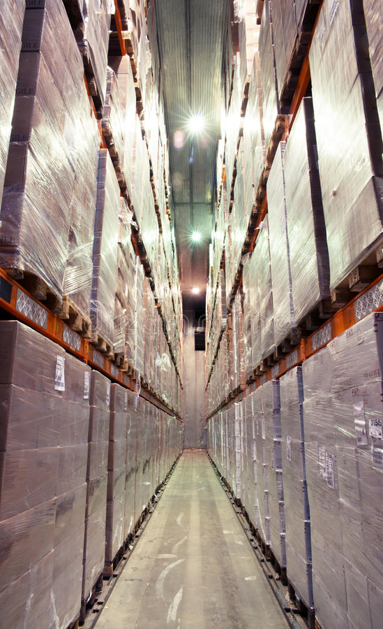 Large cold warehouse. Frozen food at shelves in cold warehouse royalty free stock photo