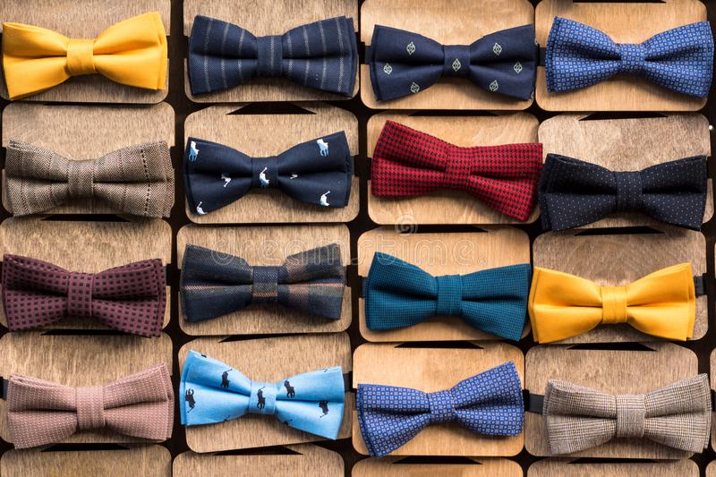 A large collection of Bow Ties of various colors. All items of clothing are on stands royalty free stock photography
