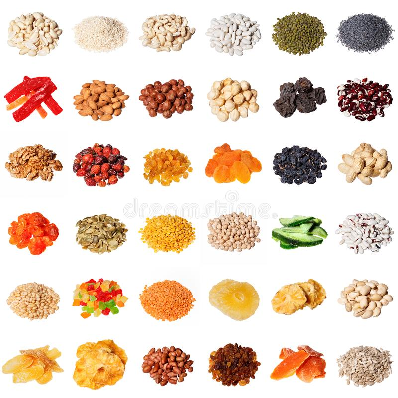 Large collection of different spices, herbs, nuts, dried fruits, beans, berries isolated on white background. stock images