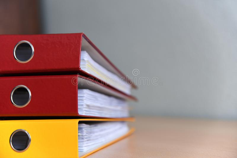 Large color folders for documents on the table in the office, close-up, copy space stock images