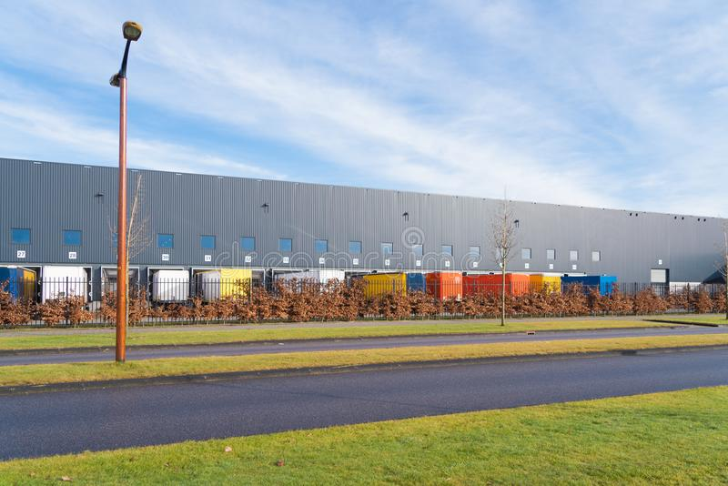 Large commercial warehouse. With trailers in front stock photos