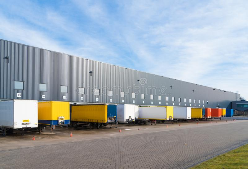 Large commercial warehouse. With trailers in front royalty free stock image