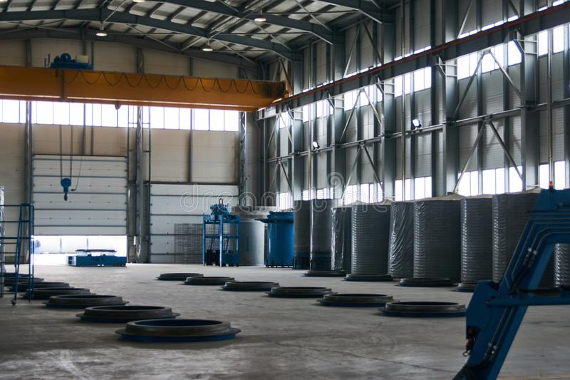 Large Concrete Factory warehouse interior. With goods royalty free stock images