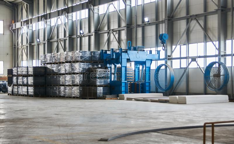 Large Concrete Factory warehouse interior. With goods royalty free stock photo