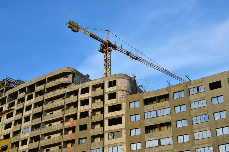 Large construction site with cranes on the blue sky background royalty free stock photo