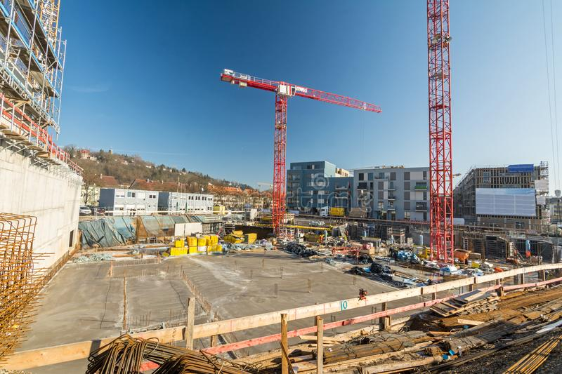 Large construction site with finished foundation, cranes and building material stock photography
