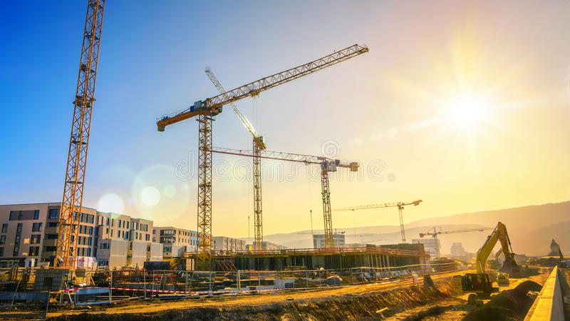 Large construction site including several cranes, with clear sky royalty free stock photography