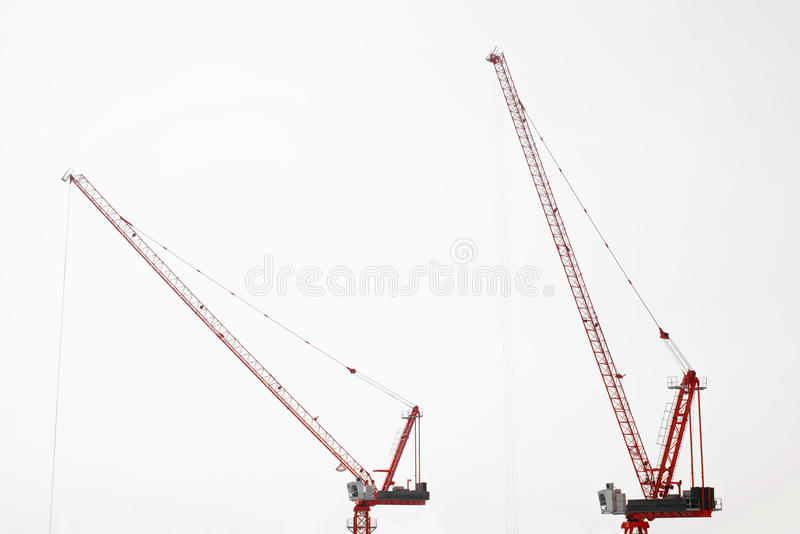 Large construction site including several cranes working on a building complex royalty free stock photo