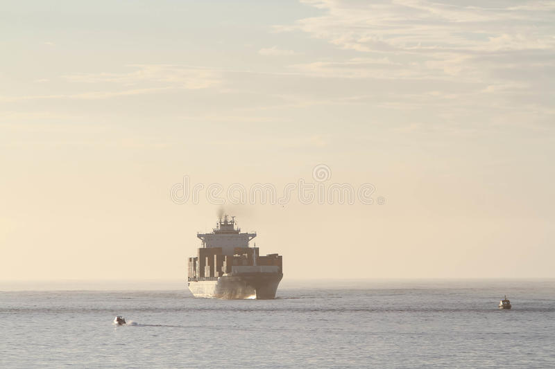 Large container cargo ship in distance royalty free stock photography