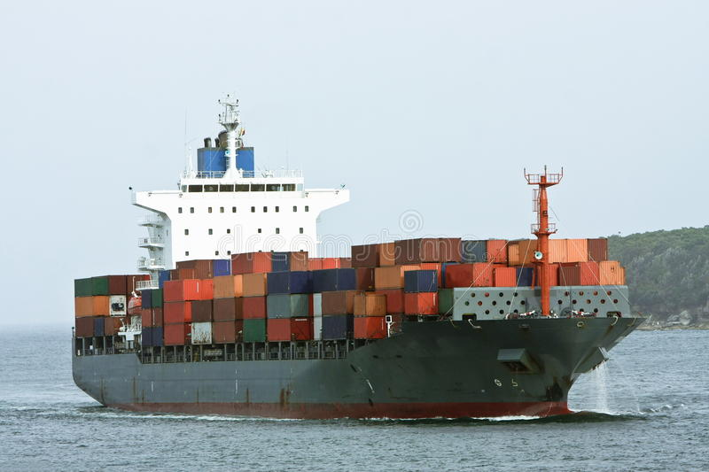 Large Container Cargo Ship At Sea. Stock Photo