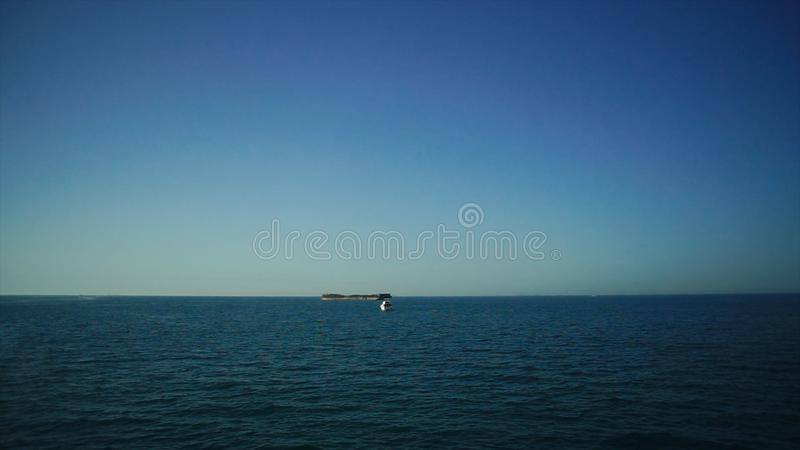 Large container ship is leaving the port full loaded with containers and cargo. Stock. Tanker at sea stock photo