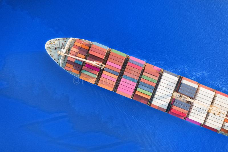 Large container ship sailing blue sea. Top aerial view royalty free stock photos