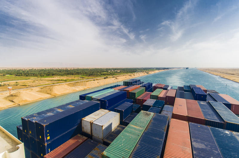 Large container vessel ship passing suez canal. stock photo
