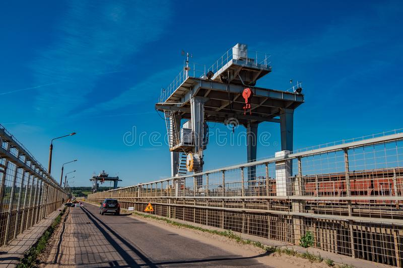 Large crane for control water gate on dam stock photo
