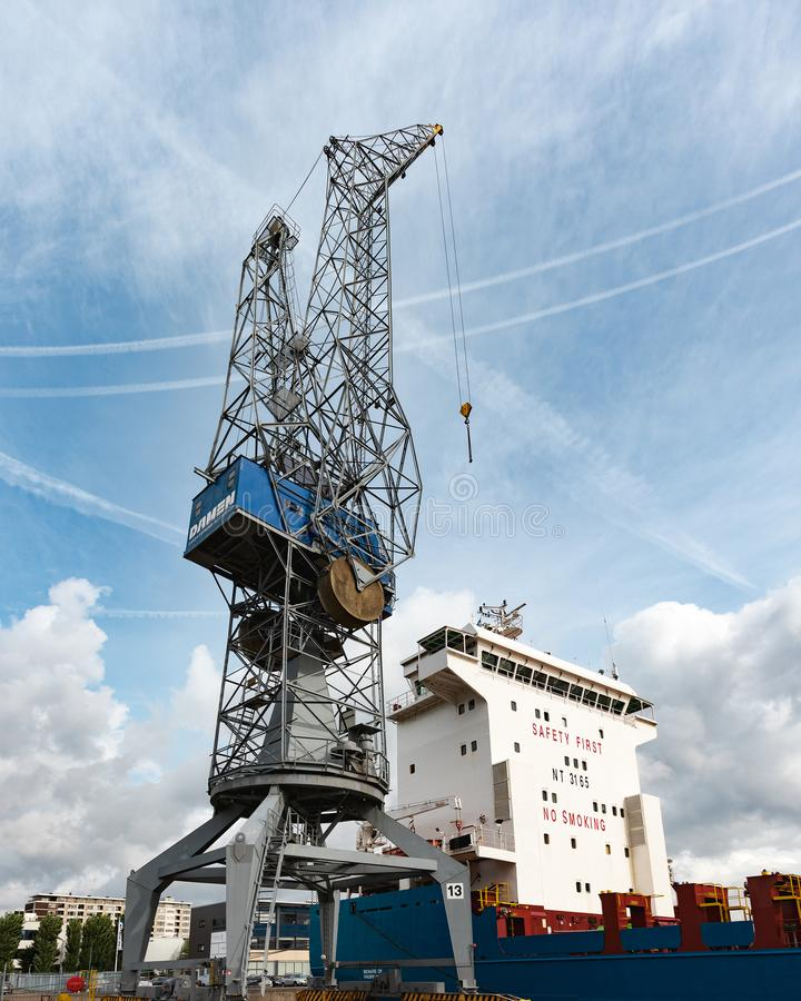 Large crane at the quay of a shipyard in Schiedam, The Netherlands. Schiedam, The Netherlands - september 22, 2018: Large crane at the quay of the Wiltonhaven stock image