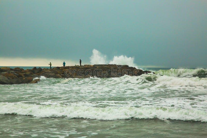 Fishing Oxnard California waves. Large crashing waves over rocks in Oxnard were people go royalty free stock image