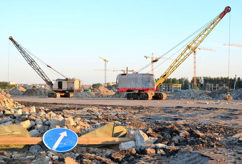 Large crawler crane or dragline excavator with a heavy metal wrecking ball on a steel cable. stock photo