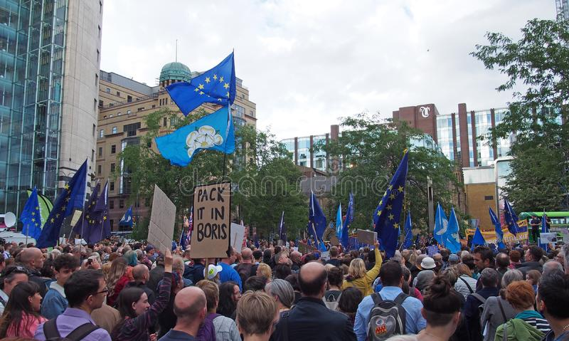 A large crowd with flags and banners at the leeds for europe anti brexit demonstration. Leeds, west yorkshire, united kingdom - 29 august 2019: a large crowd royalty free stock images