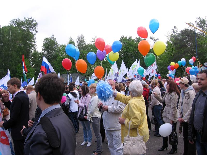 Russia, Novosibirsk, may 9, 2013: a large crowd of people with balloons and flags celebrates victory day in the city, festivities stock photo