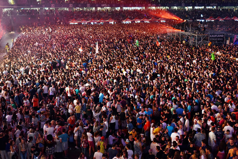 Large crowd of people at a concert in the front of the stage stock photography