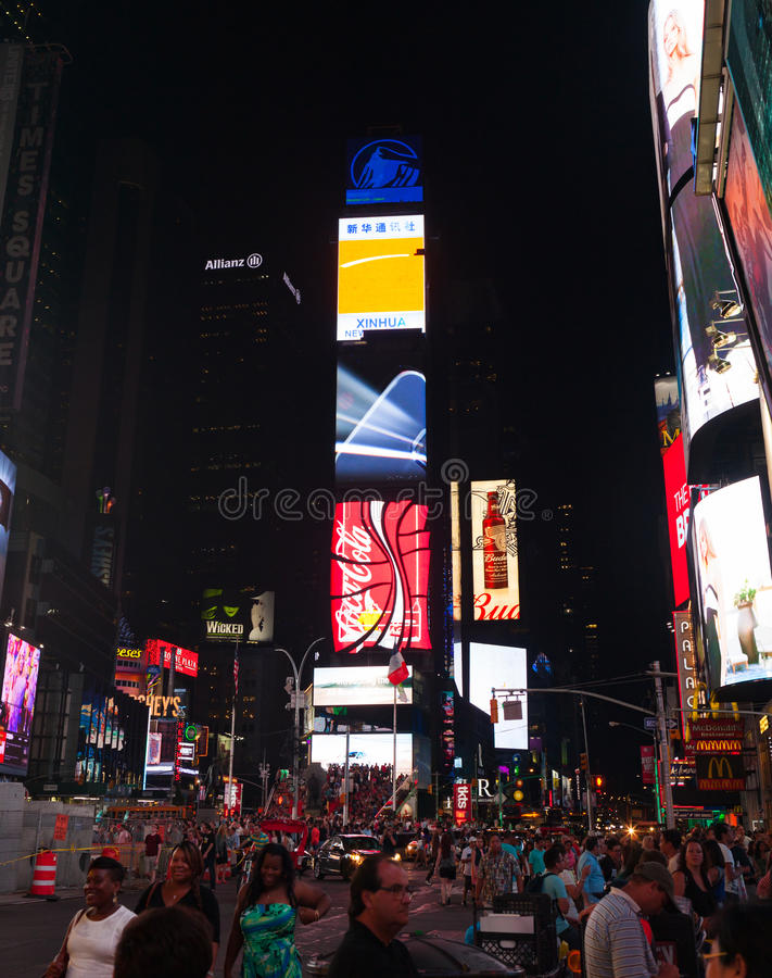 Large crowd of people in Times Square at night. New York City, Usa - July 09, 2015: Times Square, a busy tourist intersection features Broadway Theaters, LED stock images
