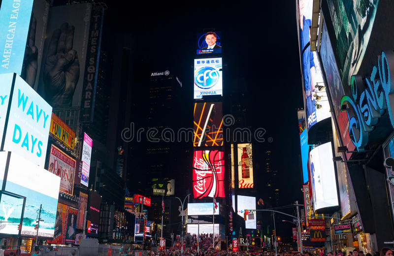 Large crowd of people in Times Square at night. New York City, Usa - July 09, 2015: Times Square, a busy tourist intersection features Broadway Theaters, LED stock photography