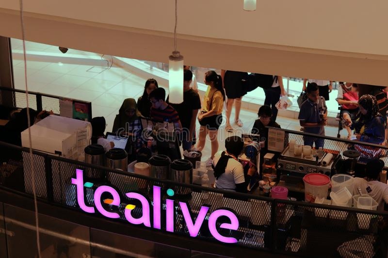 Tealive Bubble Tea Outlet At The Ipoh Parade Shopping Mall. A large crowd queueing up for their fix at the Tealive, previously Chatime, outlet at the Ipoh Parade stock photography
