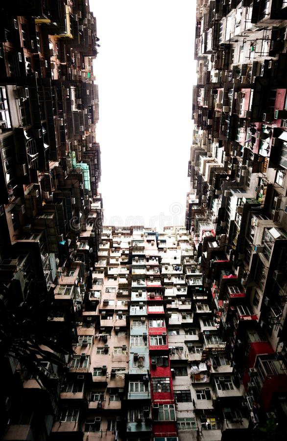 A large and crowded building in hongkong royalty free stock photos