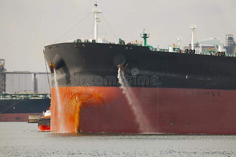 Oil Tanker Ship. Large crude oil tanker ship pumping out ballast water when coming into port royalty free stock photos