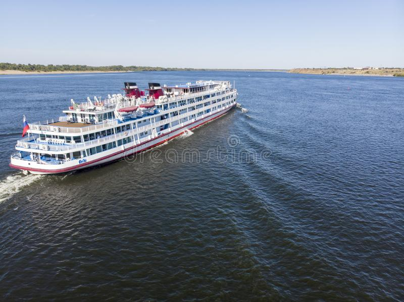 A large cruise ship with tourists on board runs along the Volga downstream towards Astrakhan. Volgograd. Russia royalty free stock images