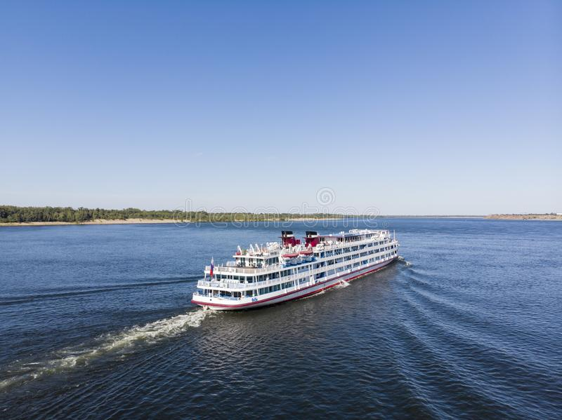 A cruise ship with tourists passes along the Volga downstream towards Astrakhan. Volgograd. Russia stock image