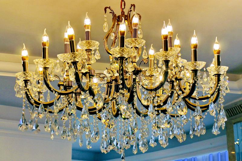 Large Crystal Chandelier Vintage Glowing In The Form Of Candelabra Candlesticks And Stock Image