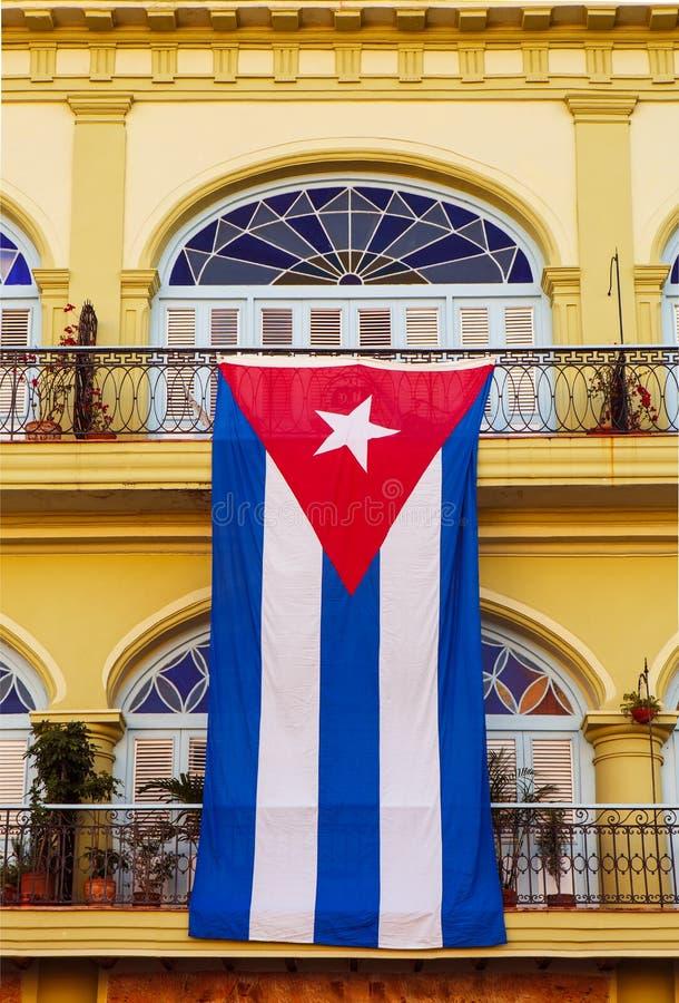 Large Cuban Flag Draping Over a Railing royalty free stock photos