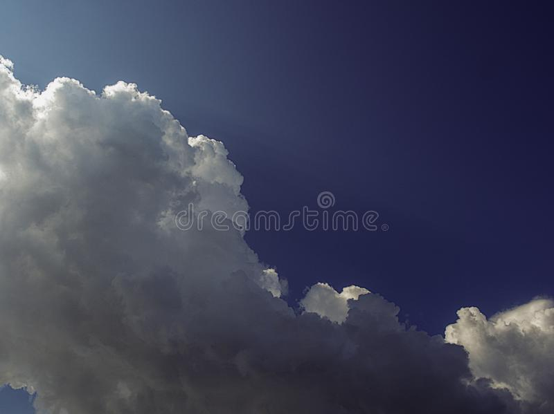 Download Large Cumulus Clouds In Front Of Thunderstorm Stock Image - Image of light, large: 109450671