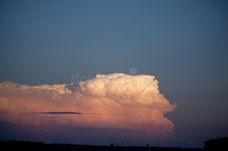 Storm clouds against blue sky in North Dakota stock photography