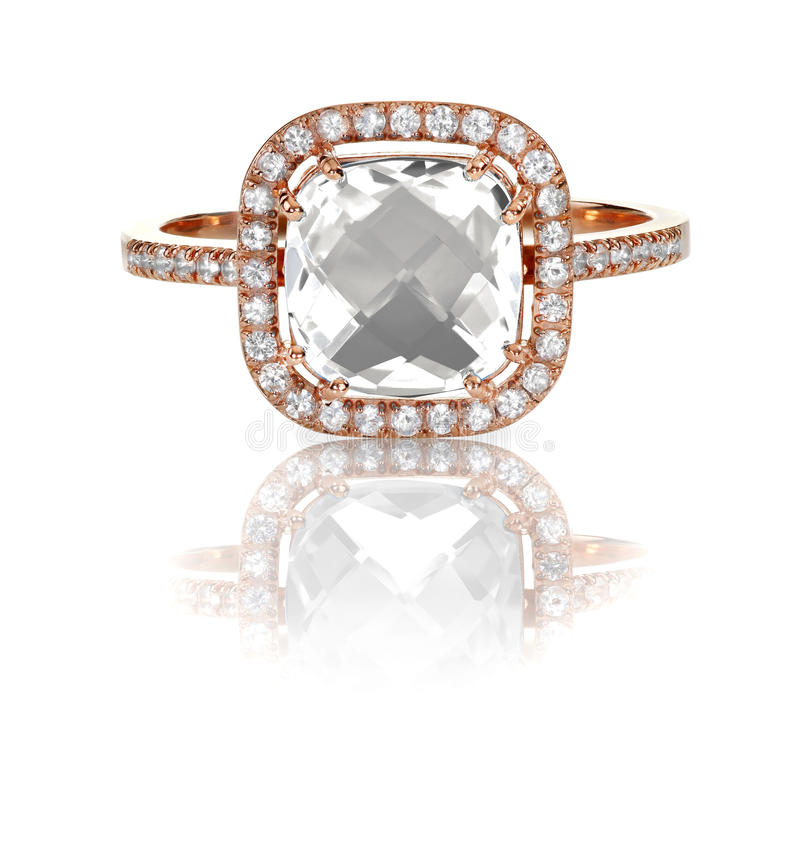 Large cushion cut modern diamond halo engagement wedding ring. A beautiful diamond halo cushion cut center stone engagement/wedding/fashion ring in a rose gold royalty free stock photography