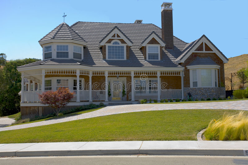 Large Custom Tudor Home. Exterior shot of a very large, newly constructed tudor home stock photo