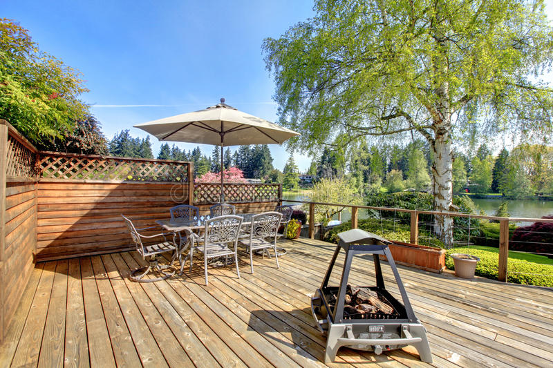Large deck with furniture and umbrella royalty free stock photography