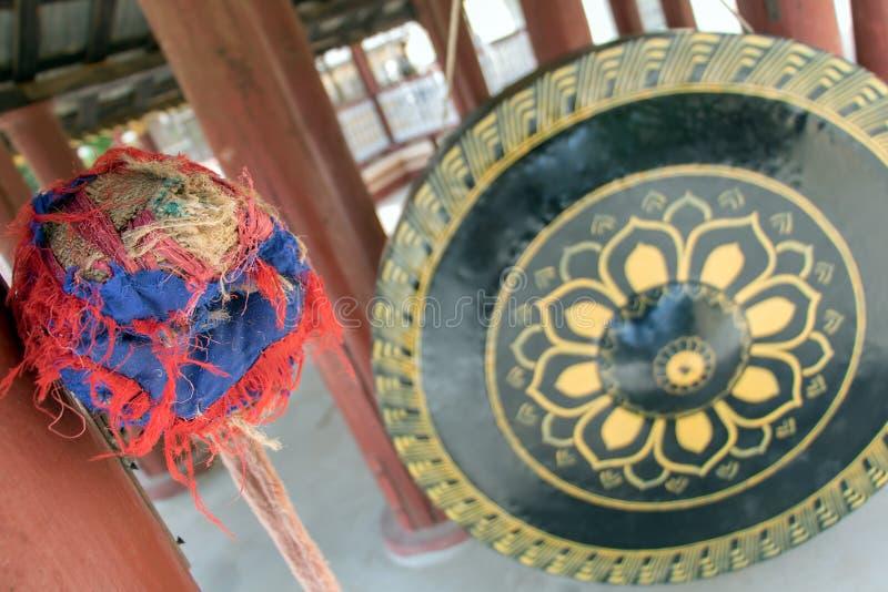 Large decorated gong with a mallet. In a Buddhist monastery The Shwezigon Pagoda or Shwezigon Paya, Nyaung-U, Bagan Myanmar stock photos