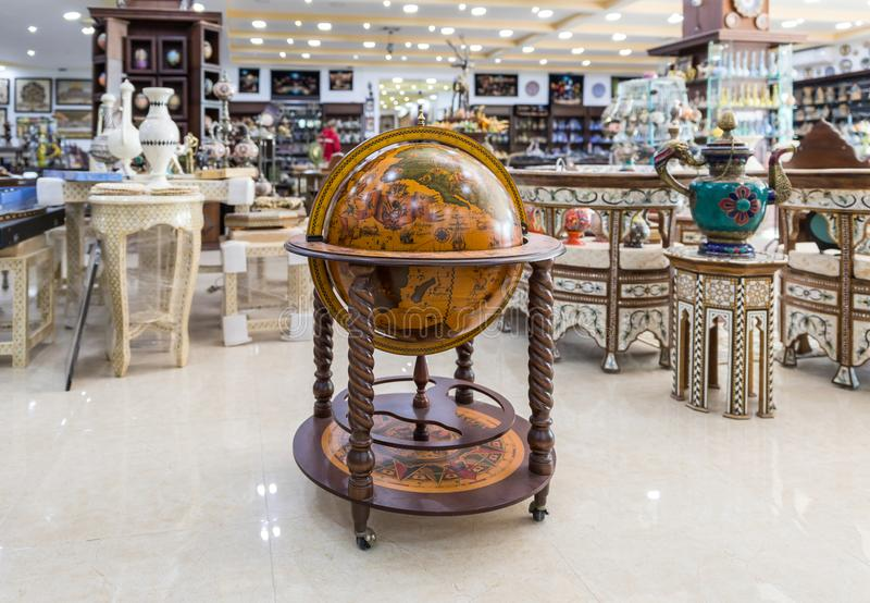 A large decorative wooden globe for sale in a roadside store near Maan city in Jordan royalty free stock photography