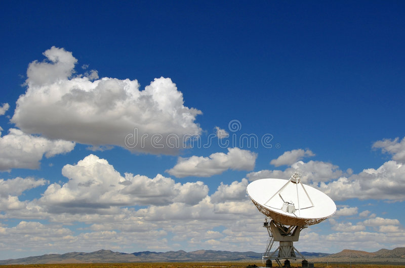Large desert radio telescope. A view of the large dish of a radio telescope in an isolated part of the desert of New Mexico stock photography