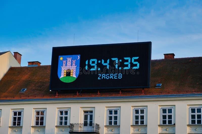 Large Digital Clock on Historic Building, Zagreb, Croatia. A large LED digital clock billboard mounted on an historic building in central Zagreb Old Town stock images