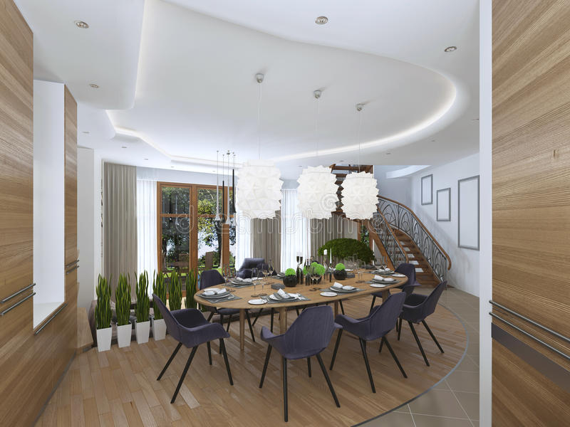 The large dining table in the kitchen area. The large dining table in the kitchen area with eight upholstered chairs and beautiful chandelier over the table stock photo