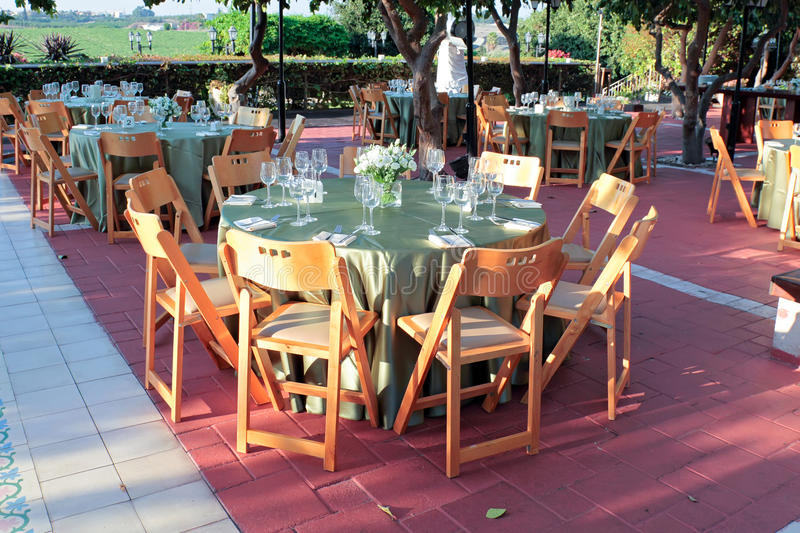 Large dining table set for wedding - outdoor. royalty free stock photos
