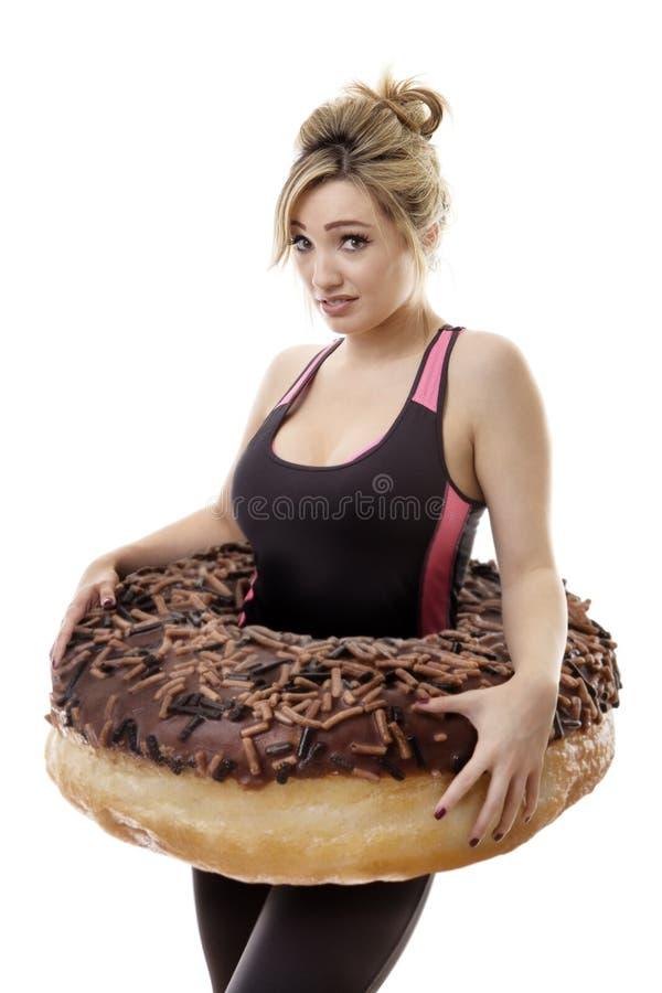 Large donut around woman royalty free stock photos