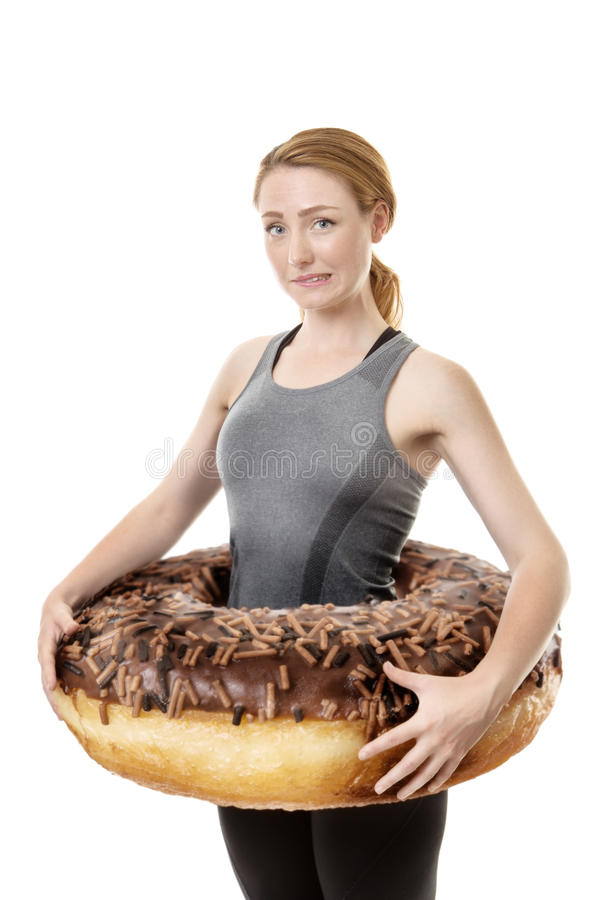 Large donut around woman royalty free stock photography